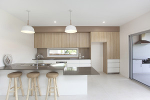 custom design kitchen with lower bench, induction cooking, soft close doors and drawers